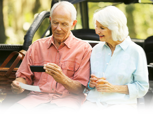 senior couple using their smartphone for mobile deposit