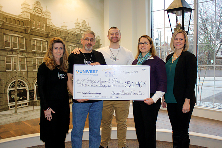 Caring for Community Giveaway winning nonprofit, Hope Against Heroin, pictured with Univest Corporate Communications team at check presentation