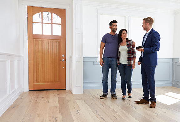 young couple touring a potential house for sale