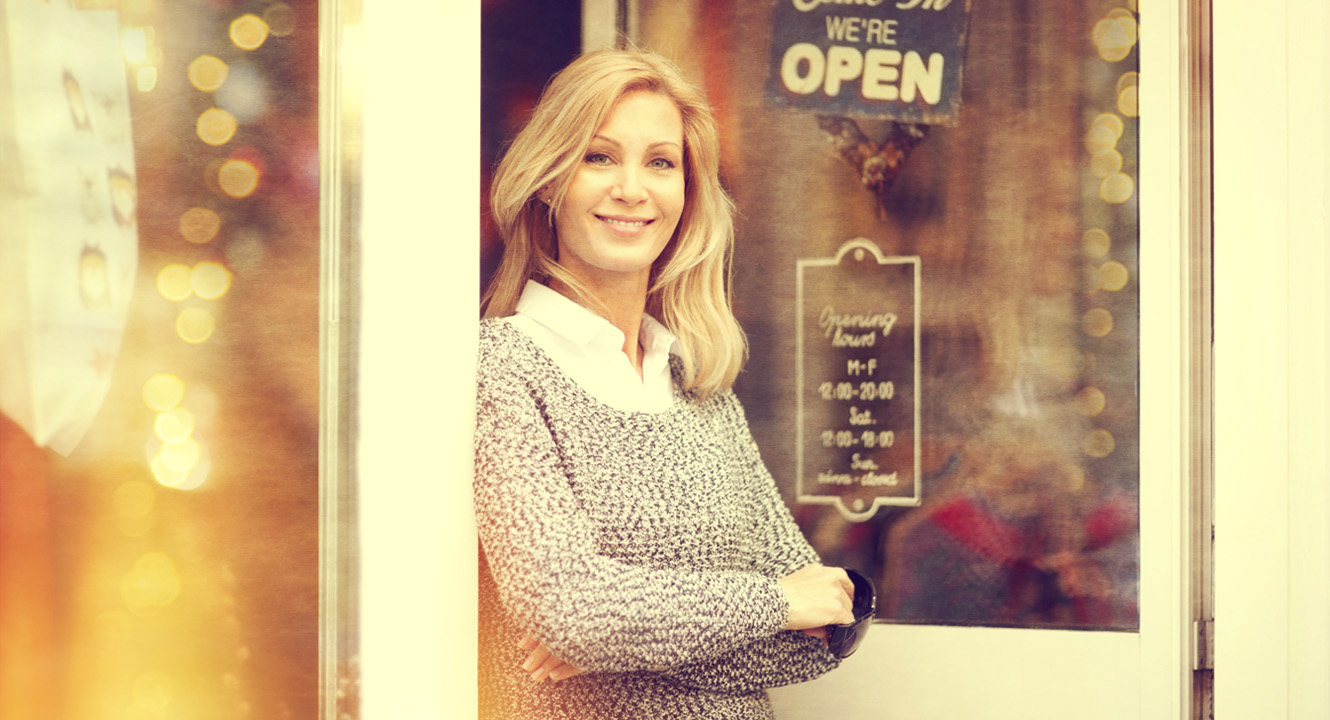small business owner standing outside her business