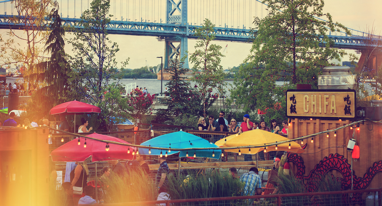 image of people hanging out on the pier at spruce street harbor park in philadelphia