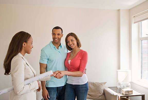 young couple meeting with their realtor