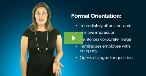 screenshot of employee orientation video showing a business woman as the narrator with a play button overlay