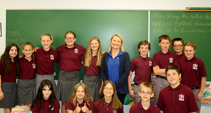Kathleen Turnure from Univest is pictured with sixth graders at St. Isidore School in Quakertown.