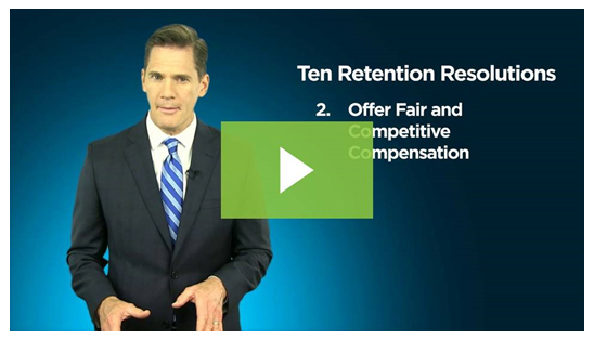 screenshot of employee retention video showing a business man as the narrator with a play button overlay